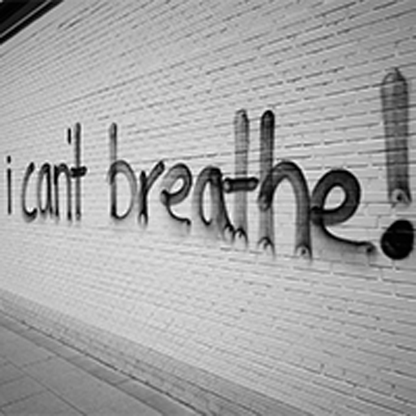 a wall with the words I can't breathe! spray painted on